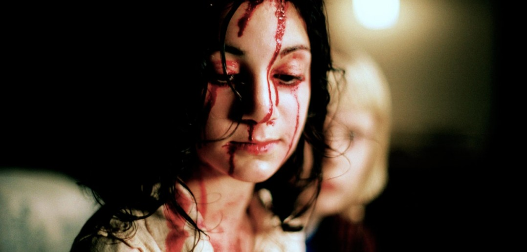 Let the right one in 2008 girl bloody face