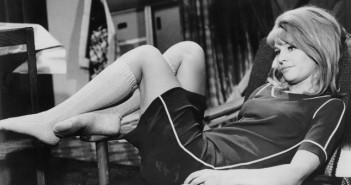 Darling 1965 julie christie reclining on a sofa in shorts