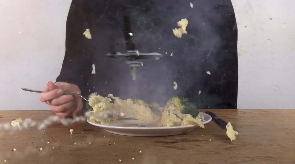Demontable short film a drone blows up a plate of mashed potato